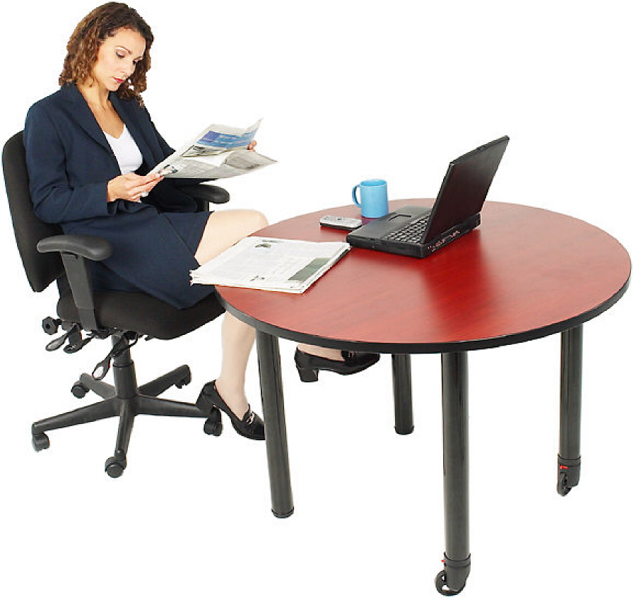 Businesswoman reading newspaper at her desk 1